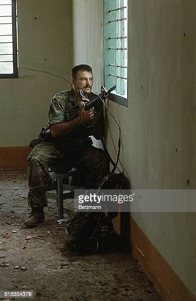 5/11/1968Saigon Vietnam Photo shows SFC Harman Strader Alton Illinois watching through the window of the third floor of a Vietnamese house He watches...