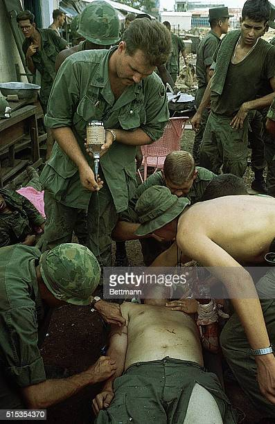 5/11/1968Saigon VietnamPhoto shows a wounded US 9th Division soldier being received and treated at the edge of the Y bridge where they had set up...