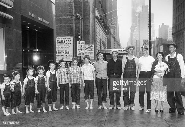 Gathered outside Robert Hall clothing store on West 34th St are members of the nation's biggest allboy familyjust arrived from Johnston CityTenn to...