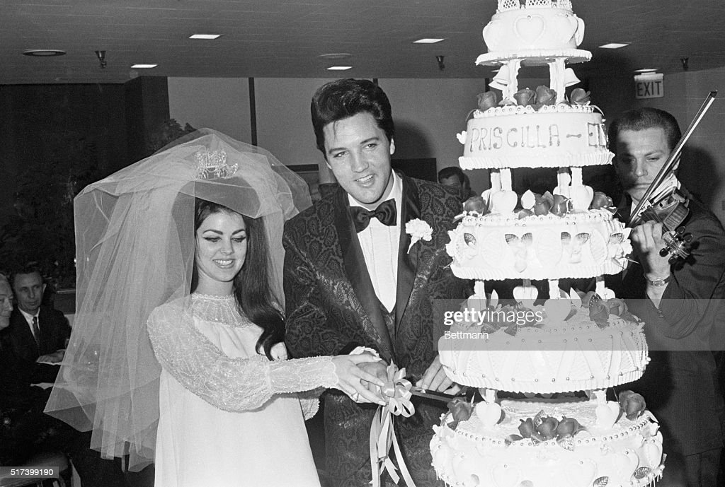 Las Vegas, NV- Singer Elvis Presley and Priscilla Ann Beaulieu, 21, cut the cake at the Las Vegas reception following their wedding, 5/1. Presley, 32, met his wife when he was in Germany in the Army in 1959. The marriage ends his reign as one of the most eligible bachelors in show business.