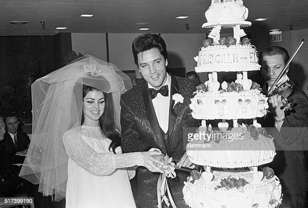 5/1/1967Las Vegas NV Singer Elvis Presley and Priscilla Ann Beaulieu cut the cake at the Las Vegas reception following their wedding 5/1 Presley met...