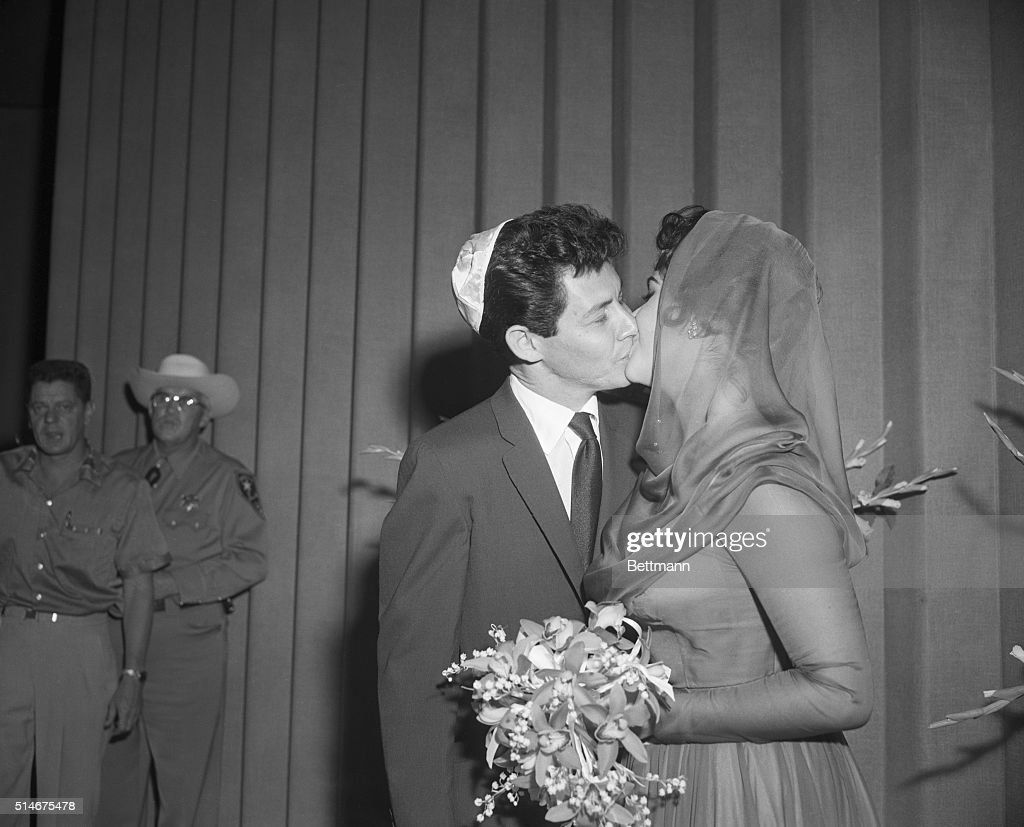 Singer Eddie Fisher Kisses His New Bride Actress Elizabeth Taylor After They Were Married