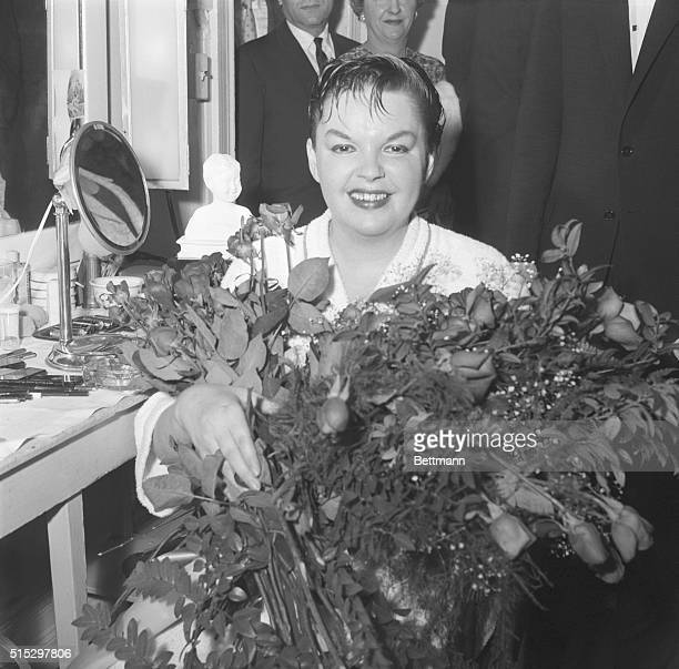 5/12/1959New York NY Singer Judy Garland smiles happily in dressing room after making her successful debut at the Metropolitan Opera House here May...