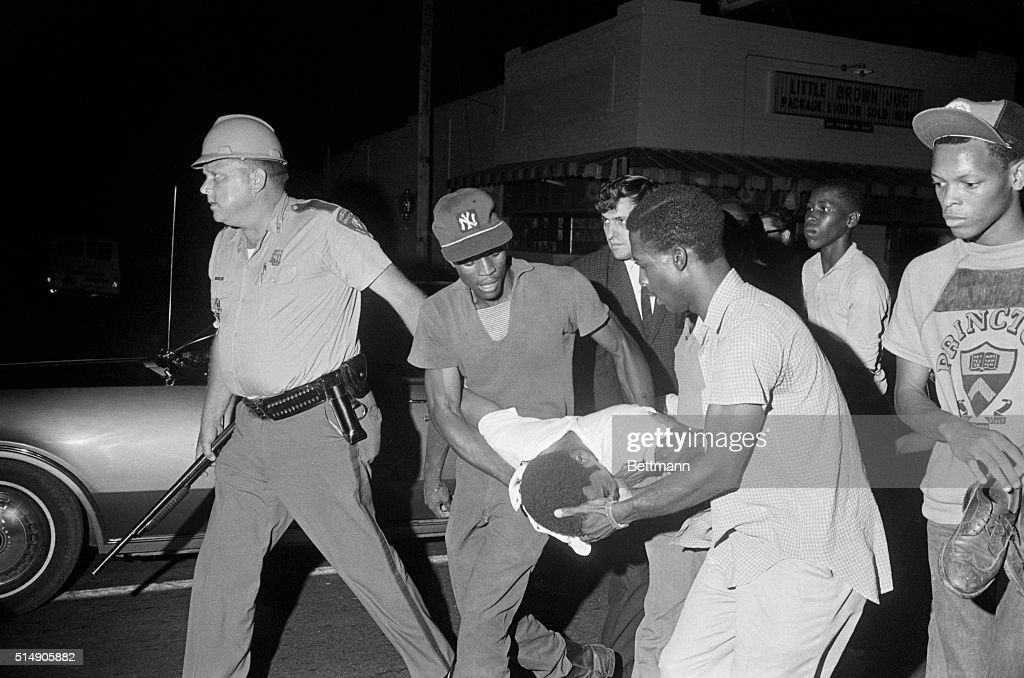 Jackson Ms A Policeman Escorts Negro Youths Through A Roadblock As They Carry 22