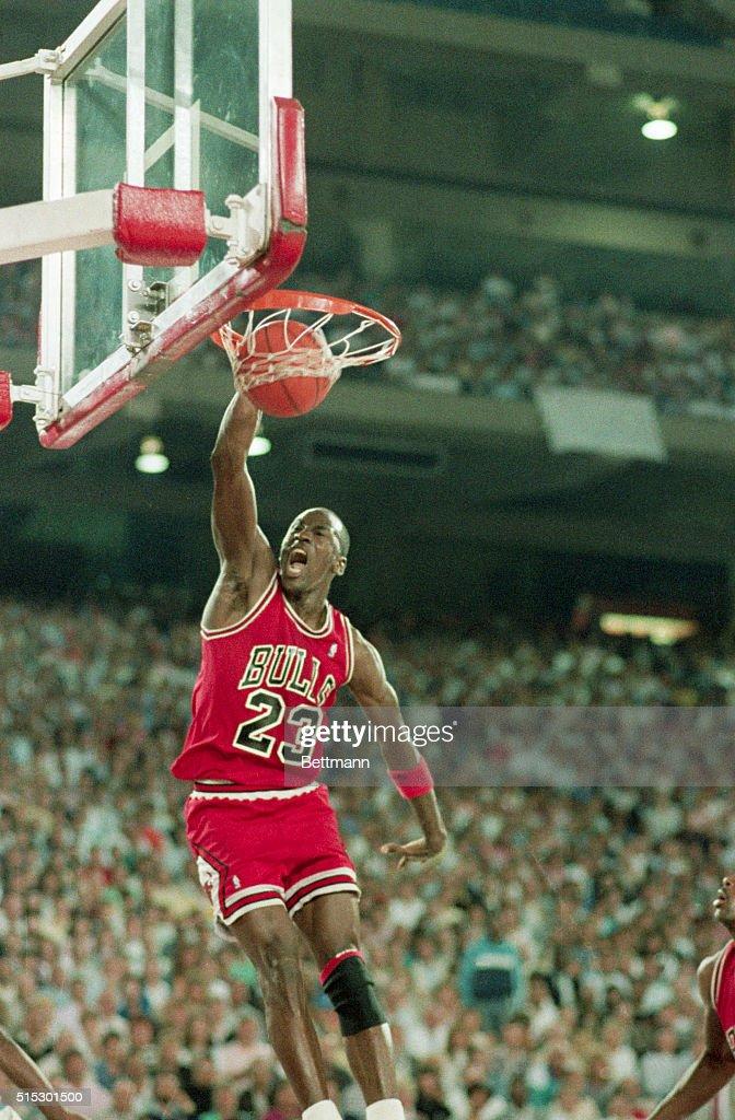 Michael Jordan Slam Dunking Basketball : News Photo