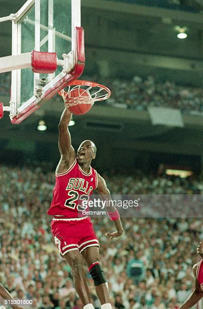 Pontiac, MI-Chicago Bulls superstar Michael Jordan slams two of his 36 points, and screams, to lead the Bulls to a 105-95 win over the Detroit...