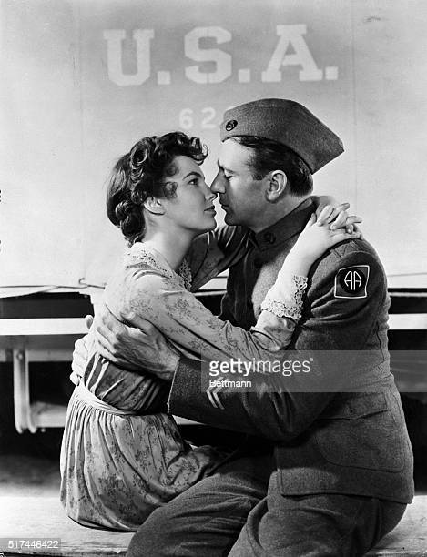 5/13/1941Los Angeles CA Just out of sight behind an Army truck Alvin C York receives an affectionate greeting from his wife Gracie played by Joan...
