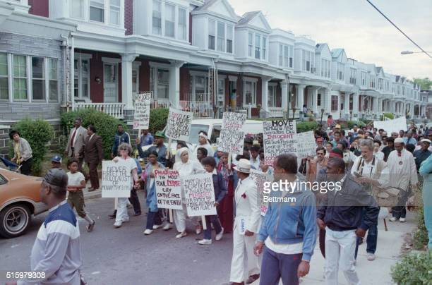Philadelphia, PA- Relatives and supporters of the radical back-to-nature group MOVE conduct an anniversary march through the Osage street...