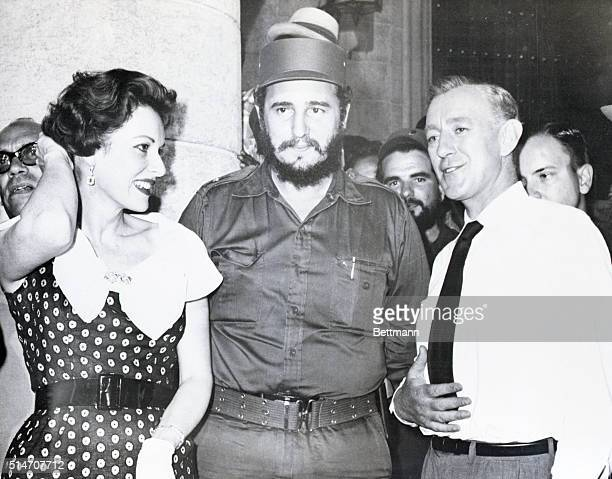 Havana, Cuba: Cuban Premier Fidel Castro is pictured with screen stars Maureen O'Hara and Alec Guinness at Havana's Cathedral Square, May 13, during...