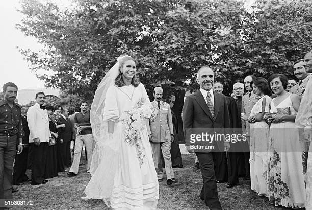 5/15/1978Amman Jordan King Hussein and American bride Queen Nur al Hussein emerge from their wedding ceremony for the cutting of the cake at the...