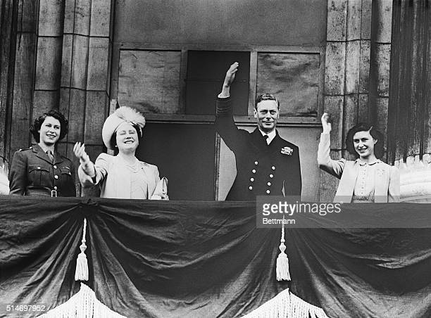 London, England: From the balcony of Buckingham Palace the Royal Family acknowledges the cheers of the throgs who gathered there on V-E day. Left to...