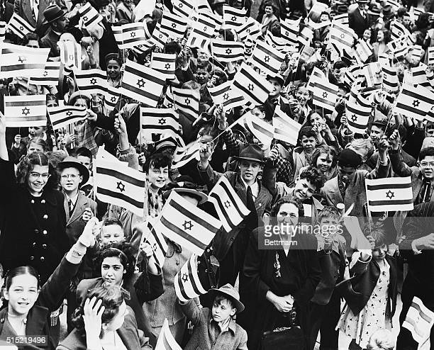 School children of Camden wave flags of the Jewish state of Israel at a mass meeting saluting the country The meeting and a march were sponsored by...