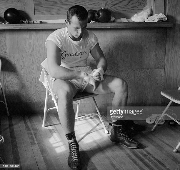 Grossinger, NY- Sitting quietly near a sunny window in his dressing room, world heavyweight champion Ingemar Johansson wraps protective bandages...