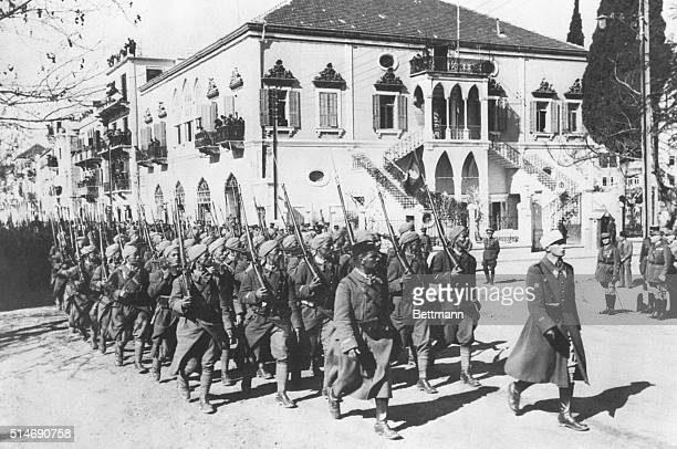 Beirut, Syria: French colonial troops shown parading the streets of Beirut, principal city of the tiny French mandate marshal Petain's decision to...