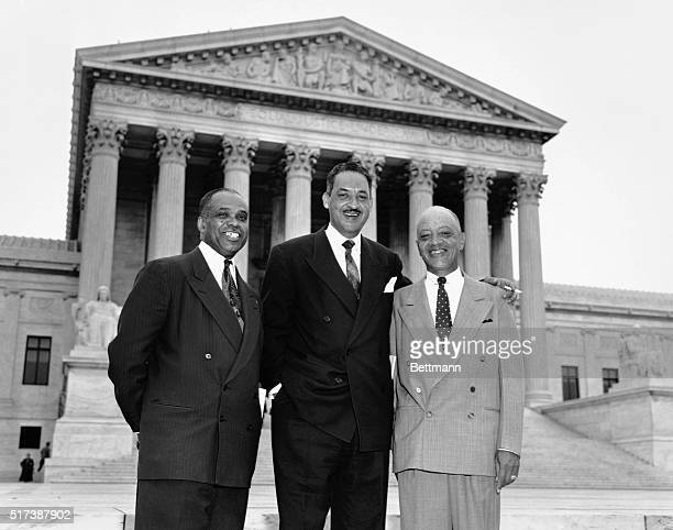 Attorneys who argued the case against segregation stand together smiling in front of the US Supreme Court Building after the High Tribunal ruled that...