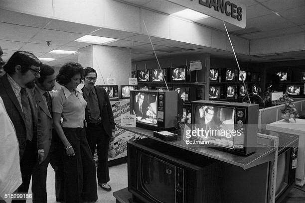 5/17/1973New York New York Customers and employees in the television section of a local department store watch the open preliminaries of the special...