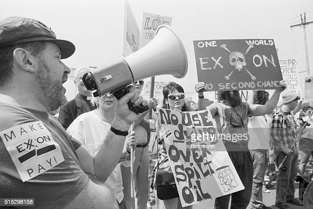5/18/1989Parsippany NJ Protesters some of them chanting 'Make Exxon pay' greet Exxon shareholders outside the hotel here where company officials...