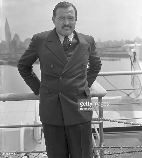New York: Ernest Hemingway, famous author who seems always in quest of adventure pictured on the S.S. Normandie on his return to America today May...