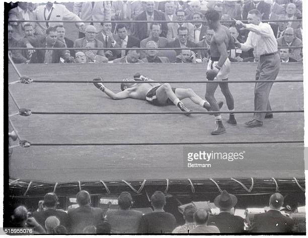 5/18/56Los Angeles CA Referee Mushyu Callahan motions Sugar Ray Robinson back to his corner after he ko'd Carl Bobo Olson in the fourth round of...