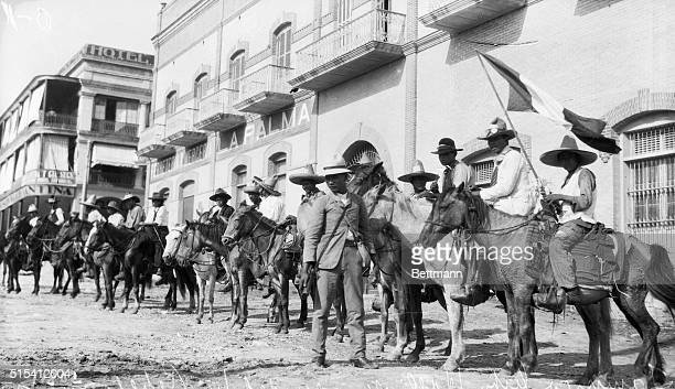 Tampico, Mexico-Photo shows the rebel cavalry after the capture of Tampico City Hall. The town is shown surrounded by rebels.