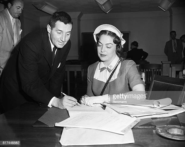 5/19/1953Los Angeles CA Esperanza Wayne wife of actor John Wayne is shown in court with her attorney Jerome Rosenthal She has asked that the court...