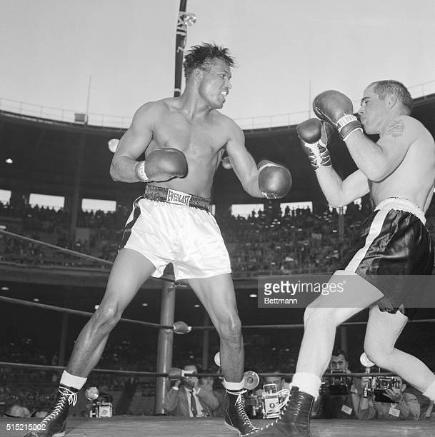 "Chicago, IL-: Sugar Ray Robinson lands the left that ended his 15-round bout with Carl ""Bobo"" Olson in the final minute of the fourth round."