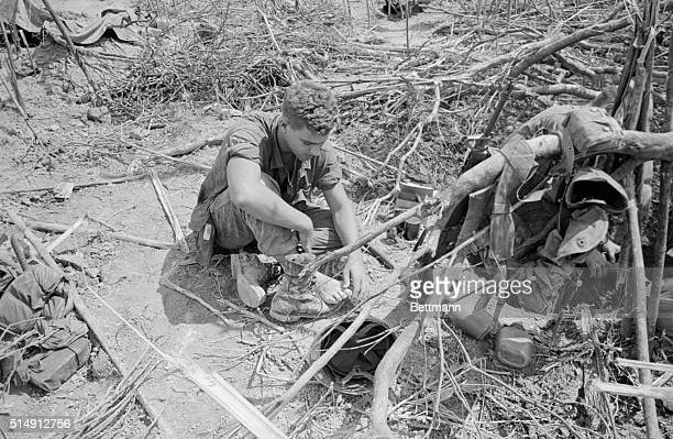 5/1967Khe Sanh South Vietnam A battleweary Marine massages his toes during a lull in the fierce fighting for Hill 881 near the Laotian border The...