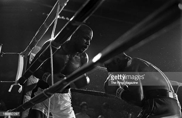 James Scott looks to land a punch to Dwight Muhammad Qawi during the fight at the Rahway State Prison on September 5, 1981 in Woodbridge Township,...