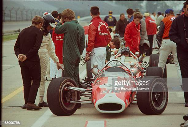 1967 51st Indianapolis 500 Driver Jim Clark talks and points something out on his Ford powered Lotus 38 to Colin Chapman