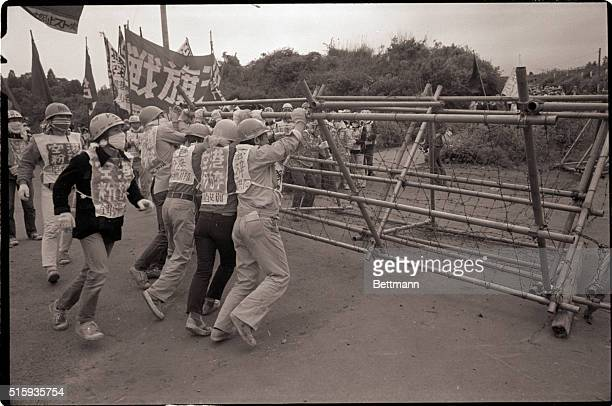 5/20/1978Narita JapanUltraleftists pull down barbed wire fence near one of the entrances to the newly opened Tokyo International Airport