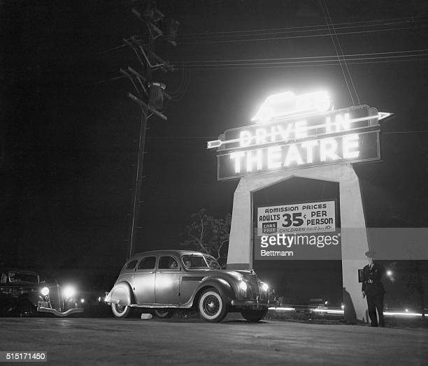 Motoring and motion pictures achieve a happy wedding in the DriveIn Theater of Los Angeles The theater is a parking lot with graduated tiers from...