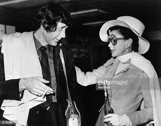 5/21/1969London England Singing star Judy Garland wearing a smart traveling outfit is shown with her recent groom musician Mickie Deans at Heathrow...