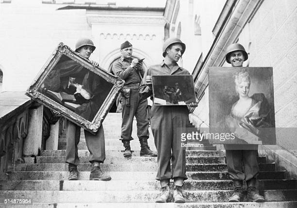 5/22/45Fussen Germany While a lieutenant checks his list in the background 7th army soldiers carry three valuable paintings down the steps of...