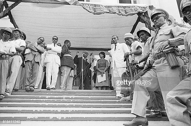 5/22/63PortauPrince Haiti ExPresident Francois Duvalier addresses the public from the porch of the Presidential Palace as armed soldiers and...