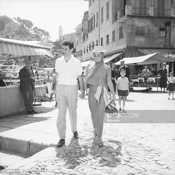 5/23/1959Portofino Italy Pipepuffing Eddie Fisher and his strawhatted wife Elizabeth Taylor stroll hand in hand in the market place here May 20 The...