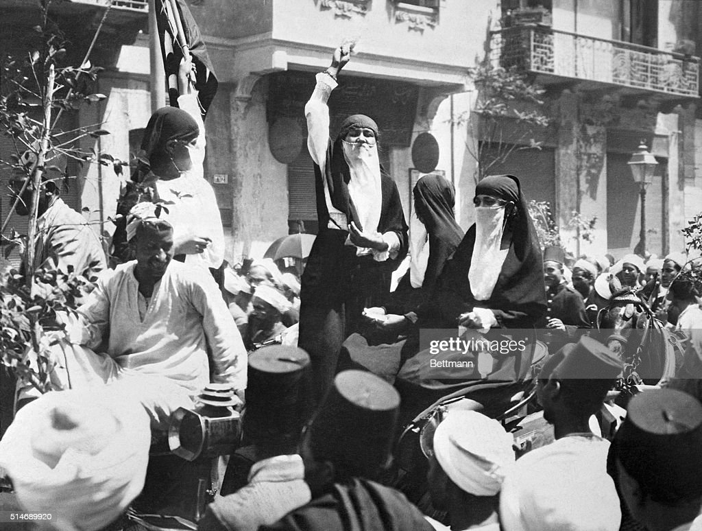 Exclusive photograph showing native Cairo women addressing a crowd in one of the principal streets of the Egyptian City. The speaker is urging greater patriotism and loyalty to their land. During her speech she cried for cheer for her land, for liberty and President Wilson. This is the first time in history that Egyptian women have been permitted freedom of speech in public. Their appearence in the thoroughfare quickly caused a great crowd to gather.
