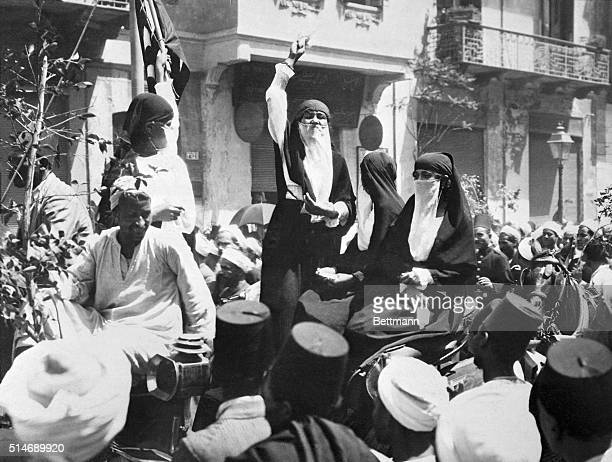 Cairo, Egypt: Exclusive photograph showing native Cairo women addressing a crowd in one of the principal streets of the Egyptian City. The speaker is...