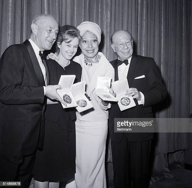 5/24/1964New York NY Winning Broadway stars display their trophies at the 196364 Tony Awards presentation Left to Right are Sir Alec Guinness best...