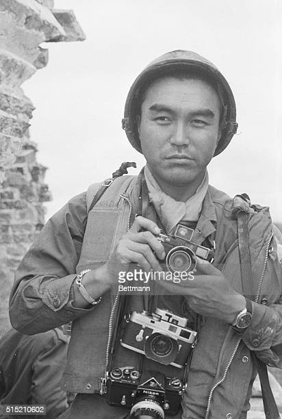 5/24/70Phnom Penh Cambodia Japanese war photographer and UPI correspondent Kyoichi Sawada stands outside the Royal Hotel after returning from a Viet...