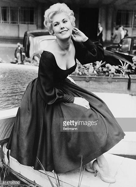 5/26/1956London England Blonde Hollywood Beauty Kim Novak here to attend the world premiere of the movie The Eddy Duchin Story brightens the London...