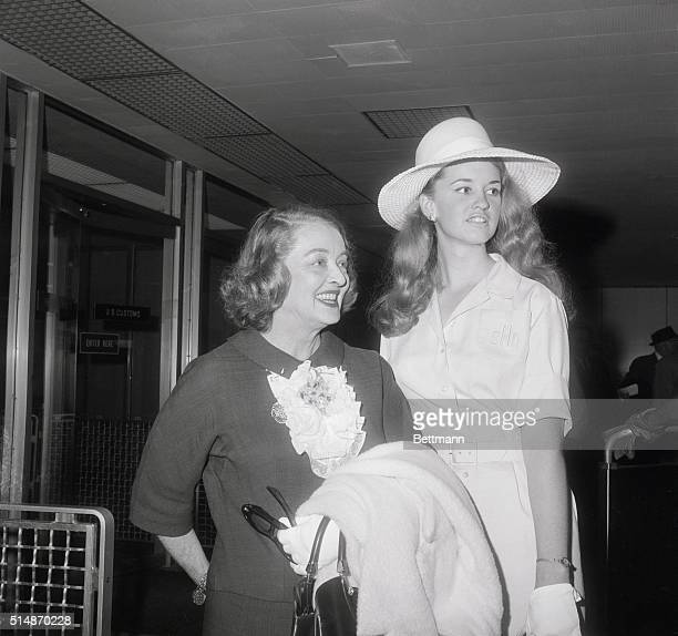 Academy Award winning actress Bette Davis smiles with pleasure upon being met by her daugther Mrs Barbara Hyman upon arrival at John F Kennedy...