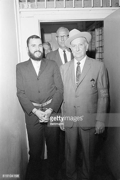 5/26/1969Decatur GA A smiling Gary Steven Krist is escorted by DeKalb County Sheriff Lamar Martin after Krist had been found guilty for his part in...