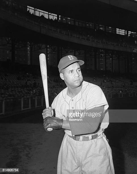 5/28/1954New York NY Wearing a dress glove on his injured hand Dodgers' catcher Roy Campanella demonstrates how ready he is to get back into the game...