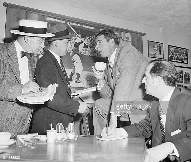 New York, NY: Joe Dimaggio, retired Yankee slugger, taks to newsmen in the Press Room at Yankee Stadium in a pre-game discussion, May 29. Earlier in...