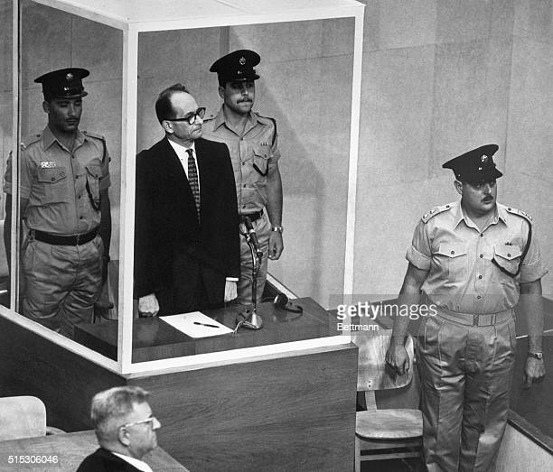 Jerusalem, Israel- Adolf Eichmann, accused Nazi mass murderer, stands in his bullet-proof glass cage to hear Israel's Supreme Court unanimously...