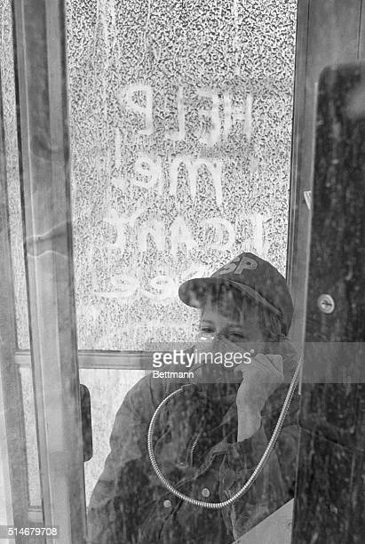 Longview, WA: Jeff Trickey of Longview, WA, takes a phone call from a downtown phone booth that is still covered with ash from the 5/25 volcanic ash...