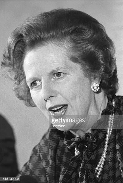 Williamsburg, VA- British Prime Minister, Margaret Thatcher, talks with reporters before flying to London. Mrs. Thatcher said the economies have...