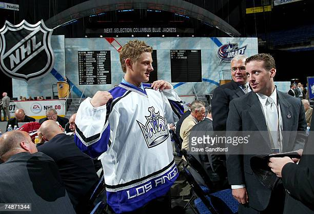 52nd overall pick Oscar Moller of the Los Angeles Kings puts on his new team jersey during the 2007 NHL Entry Draft at Nationwide Arena on June 23...