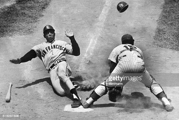 New York, NY- Slugger, Willie Mays, of the San Francisco Giants, slides into home plate safely after he tripled and came in when outfielder, Roy...