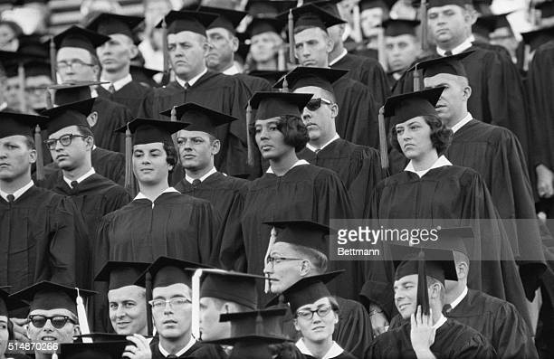 Tuscaloosa, AL: Vivian Malone becomes the first negro to graduate from the University of Alabama. She is shown standing to receive the conferring of...